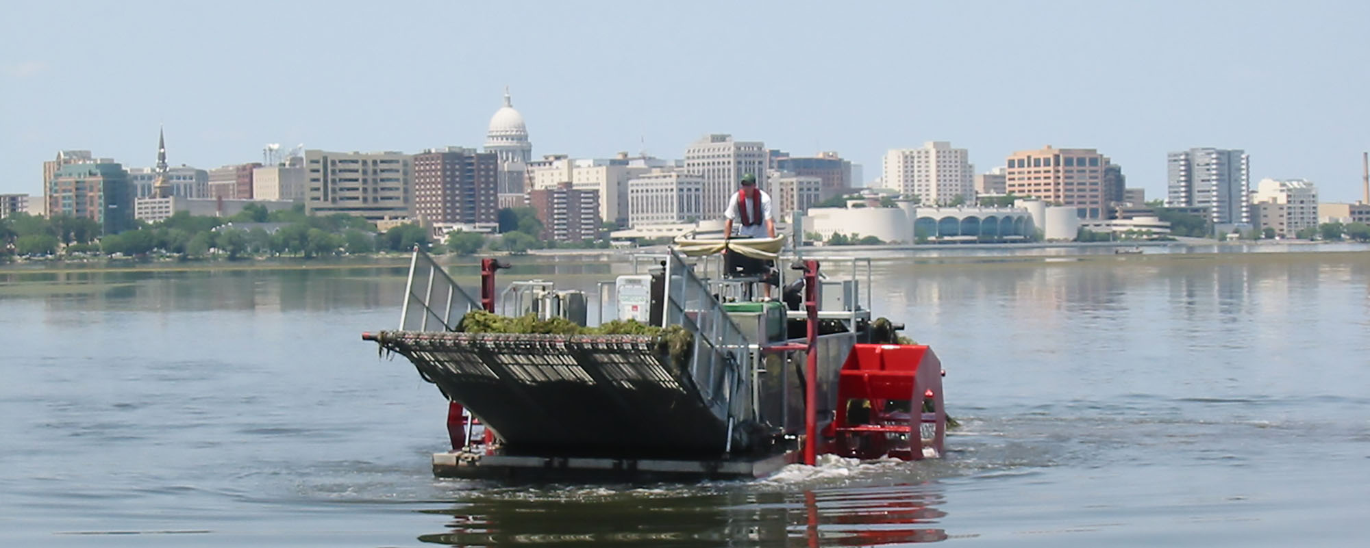 A weed harvester on Lake Monona.